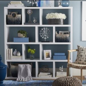beautiful boxes, vessels or bowls to store things that will help to keep the shelves free of clutter and add some style